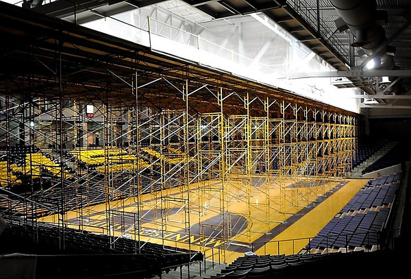 Scaffolding stretches across the basketball court at Minnesota State University's Bresnan Arena as workers install soundproofing material on the arena's ceiling.