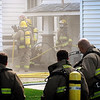 John Cross<br /> North Mankato firefighters work to extinguish a fire in the 400 block of Sherman Street, Monday.