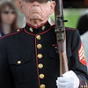 John Cross<br /> Former marine Jack Collin, Mankato, stands at attention as part of a color guard at one of Monday's Memorial Day Services.
