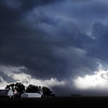 John Cross<br /> Menacing storm clouds swirl and high winds kick up clouds of dust between Mankato and Nicollet Thursday.
