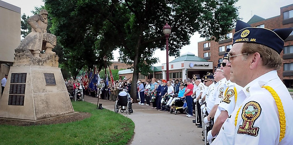 John Cross<br /> People gather at the Korean War Memorial at the corner of Riverfront Drive and Main Street Monday for a Memorial Day ceremony.