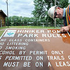 John Cross<br /> Mankato city employee Les Lotton readies a sign listing the new rules for Hiniker Pond Friday. The signs now are posted and the new rules in effect.