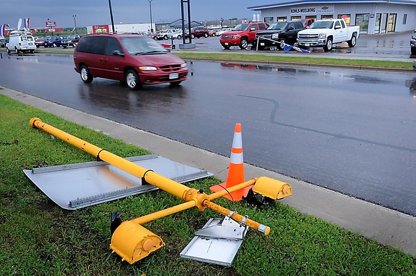 John Cross<br /> A traffic signal was blown down along Highway 14 on the west end of New Ulm during Wednesday's storm. Several cars in the nearby Kohls-Weeborg Cheverolet dealership also were damaged by the high winds.
