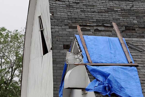 A barn and outbuildings on the Randy Schleeve farm show damage from Wednesday's storm.