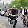 Participants in the Mankato Tweed Ride bike along South 2nd Street on their way to Sibley Pakr, Saturday, to retrace a route taken by a parade of bicycles in 1895.