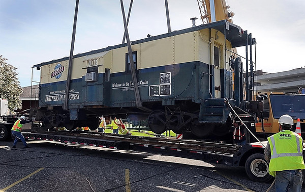 John Cross<br /> Crews guide a caboose that once served as a visitor's cener in front of the old Mankato Depot onto a flatbed trailer Friday for a move to Riverfront Park where it be utilized as a ticket booth.