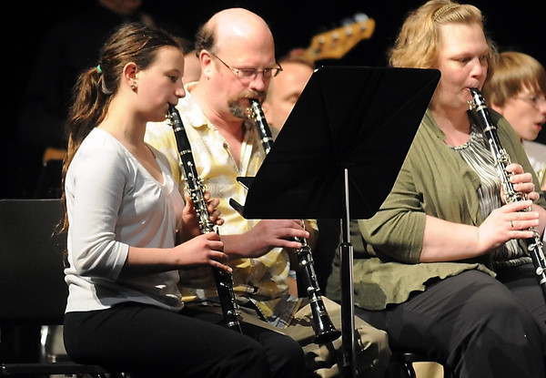 Pat Christman<br /> Minnesota State Orchestra director Joe Rodgers plays the clarinet with his daughter Anya during a middle school band concert Thursday at the Mankato East Auditorium. Parents, grandparents and siblings played a Beach Boys medley with their band members during the concert.