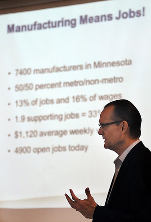 John Cross<br /> Bill Kill of Enterprise Minnesota explains the results their annual manufacturing survey to local officials and business owners Wednesday at South Central College.