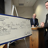 John Cross<br /> Waseca Hospital Administrator Jeff Carlson views a facsimile check for the $50,000 donation that former hospital executive Dick Sankovitz (back) made on Tuesday to help pay for a $4.7 million remodel of the emergency room.