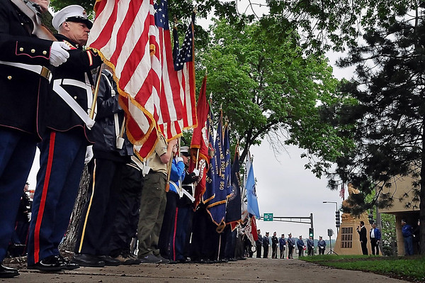 John Cross<br /> Color guards line the sidewalk near the Korean War Memorial near the Blue Earth County Library Monday for a Memorial Day ceremony. The event was one of dozens that were held throughout the area to commemorate the day.