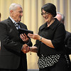 Pat Christman<br /> Loyola High School principal Shelley Schultz presents Harold Gifford, 89, with an honorary diploma during the school's graduation ceremony Wednesday. Gifford was to graduate from the school in 1943 when he enlisted in the military during World War II.