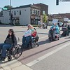 Trudy Kunkel (left), a Mankato City Council member leads a line of people in wheelchairs during a SMILES awareness event last October in downtown Mankato. File photo