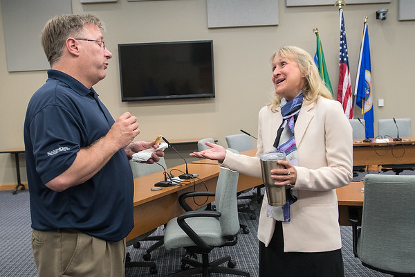 Mankato Mayor Eric Anderson (left) listens to mayoral candidate Shari Kagermeier after a brief mayoral forum held at the Intergovernmental Center on Wednesday. Anderson is not seeking re-election as mayor this fall. Photo by Jackson Forderer