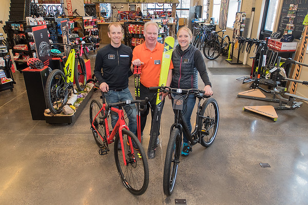 """From left, Justin Rinehart, Jon Andersen and Jenna Rinehart at Nicollet Bike and Ski. Andersen, former owner of the Flying Penguin, said he is carrying on the family tradition of selling ski gear since the 1930's in a sport he loves and added, """"I can't think of doing anything else but this."""" Photo by Jackson Forderer"""