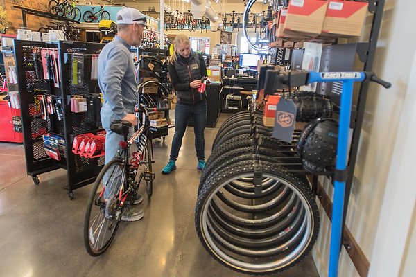 Jenna Rinehart helps out Gary Winters at Nicollet Bike and Ski. The store officially changed its name on March 1 after merging with the Flying Penguin. Photo by Jackson Forderer