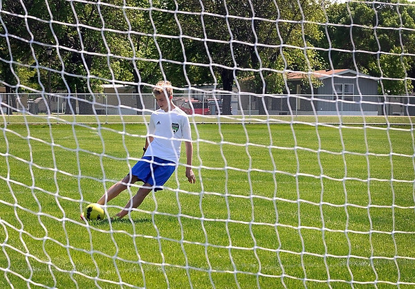 Mankato United soccer player Sam Ambrose takes the first shot at a goal on one of the new soccer fields at the Caswell North Soccer Complex during its grand opening Wednesday in North Mankato. Photo by Pat Christman