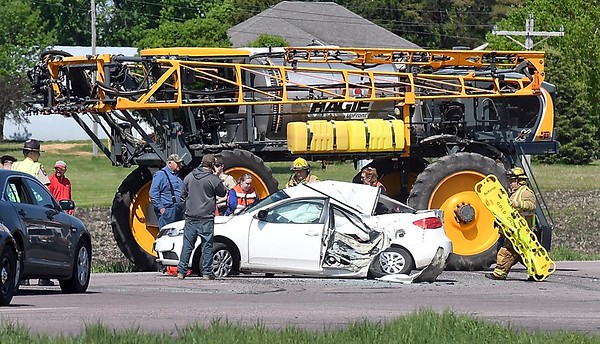 Sprayer and car collide on County Road 83