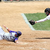 Minnesota State's Matt Odegaard slides into home ahead of the tag by St. Cloud State catcher Travis Enger during their first game in the NSIC championship Saturday at Franklin Rogers Park.