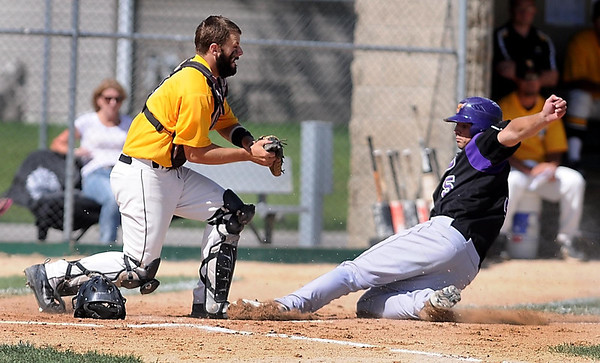 Minnesota State's Mike Eckhart slides safely in to home plate under the tag of Wayne State catcher Luke Abkes during the second inning of their NSIC tournament game Thursday at Franklin Rogers Park.