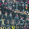 Graduates walk past their instructors while taking their seats during South Central College's commencement ceremony Thursday at the Verizon Wireless Center.<br /> <br /> Pat Christman