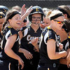 Mankato East's Coley Ries is congratulated by her teammates after hitting a three-run home run in the first inning of their game against Winona Saturday at Thomas Park.