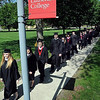John Cross<br /> Bethany Lutheran College graduates file across campus Friday for spring commencement.