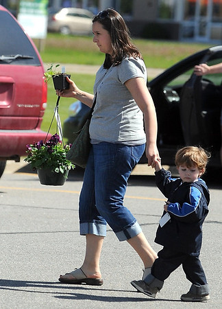 Chirssy Karst and her son Henry, 2, leave Drummer's Garden Center with flowers for themselves and Karst's mother Saturday.