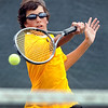 Mankato East's Brendan Loayza returns a shot at the net during his doubles match Friday at the East courts.