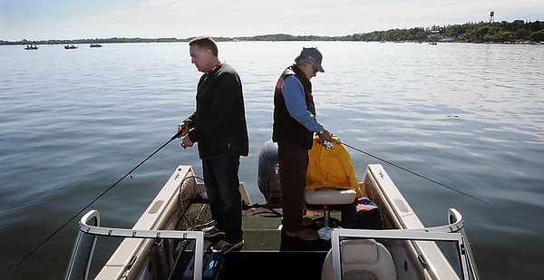 John Cross<br /> Governer's Opener fishing host Tom Barrett of Waconia (left) and Dan Thomas of Chicago, Ill., fish on Lake Waconia Saturday.