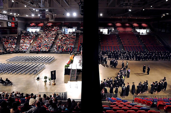 Empty seats and stands full of family and friends await South Central College graduates on the other side of the curtain during the school's commencement ceremony Thursday at the Verizon Wireless Center.