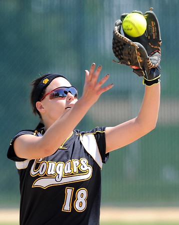 Mankato East's Jordan Kuster makes a catch during their game against Winona Saturday at Thomas Park.