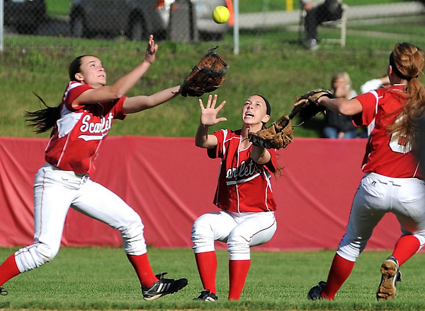 Mankato West fielders (from left) Megain Svir, Lauren Makela and Kinzie Scearcy all run for a pop fly during their game against Mankato East Tuesday. Svir made the catch.