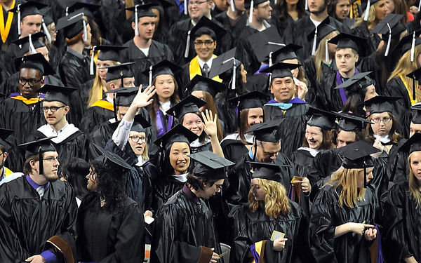 Pat Christman<br /> A pair of Minnesota State graduates wave to family and friends during the first of three commencement ceremonies Saturday at Taylor Center.
