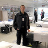 Brian Ojanpa<br /> Minnesota Mobile Medical Unit Medical Director Jim Harris stands in the 8-bed unit that can accommodate 16 beds if needed.