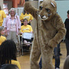 Amanda Dyslin<br /> Kennedy Elementary School celebrated its School of Excellence award at an assembly Thursday, and their Cub mascot made a special appearance to high-five the kids.