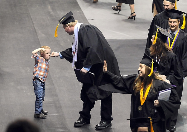 Ryker Maland, 5, congratulates his uncle Dylan Chandler after he received his degree during the first of three commencement ceremonies Saturday at Minnesota State University's Taylor Center. Photo by Pat Christman