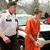 Seventeen-year-old John LaDue is escorted to his initial court appearance at the Waseca County Court House by Waseca County Jail Administrator Tim Kinniry on Monday. Photo by John Cross