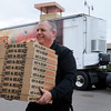 Jeff O'Meara, driver of the Little Caesars Love Kitchen, carries an armload of freshly-cooked pizzas into the Salvation Army to be served at the noon lunch on Tuesday. The mobile pizza kitchen travels the lower 48 states and several Canadian provinces serving the hungry, homeless and disaster victims. Photo by John Cross