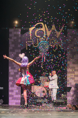 Rachel Flowers, as Kandy Perry, waves to the audience and the band Pop Rocks as she walks off the runway as the last model in the RAW Fusion fashion show. Photo by Jackson Forderer