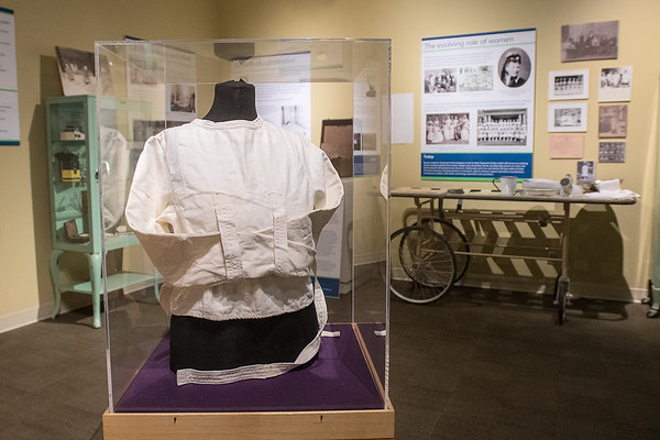 A strait jacket inside a display case at the State of Mind: A History of Minnesota's First State Hospital exhibit at the Nicollet County Historical Society. The exhibit is running in conjunction with Changing Minds Too at the Arts Center of St. Peter which features artwork by patients from the state hospital. Photo by Jackson Forderer