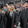 Heidi Selnes waves to family members in attendance at the South Central College commencement held in Bresnan Arena on Thursday. Selnes graduated with a Licensed Practical Nursing degree. Photo by Jackson Forderer