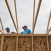 Ben Schmillen (right) directs Mitch Brown as the two worked with volunteers in building a Habitat for Humanity house in Nicollet. Photo by Jackson Forderer