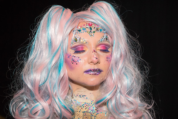 Kallie Kleinschmidt poses for a portrait backstage at the RAW Fusion fashion show. Kleinschmidt modeled for Bellissimo Paint and Coatings as Candy Coated Kallie. Photo by Jackson Forderer