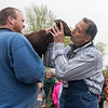 Washington Elementary Principal Shane Baier kisses Coco the goat on the playground outside of the school on Friday. Baier promised to kiss the goat if his school raised more than $9,000 for their annual PTO fundraiser Walk-A-Thon. The total is now $12,000 and counting. Photo by Jackson Forderer