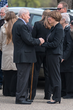 Harold Griffin (left), brother of Quentin Gifford, shakes hands with U.S. Senator Amy Klobuchar who was in attendance for Quentin's internment at Fort Snelling Cemetery on Saturday. Photo by Jackson Forderer