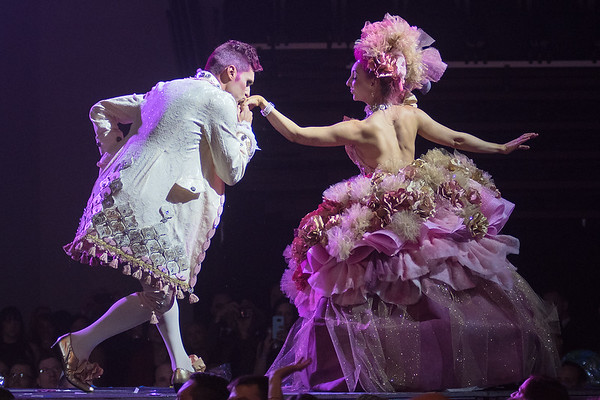 Riley Weber gives a kiss to Kelsey Chester as the two walked the runway at the RAW Fusion fashion show. Weber and Chester, modeling the characters Cotton Candy Prince and Princess for Cherry Creek won the people's choice award. Photo by Jackson Forderer
