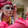 Kim Ruby puts some finishing touches onto Charlis Anzalone's makeup before the start of the RAW Fusion fashion show. Photo by Jackson Forderer