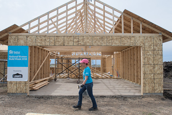 Charla Andrus walks past the garage area of a Habitat for Humanity house being constructed in Nicollet. Lowe's and Habitat for Humanity South Central MN are hosting National Women Build Week, which is building for the first time in Nicollet. Photo by Jackson Forderer