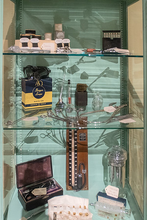Some antiquated medical equipment in a display case at the State of Mind exhibit in the Nicollet County Historical Society building in St. Peter. Photo by Jackson Forderer