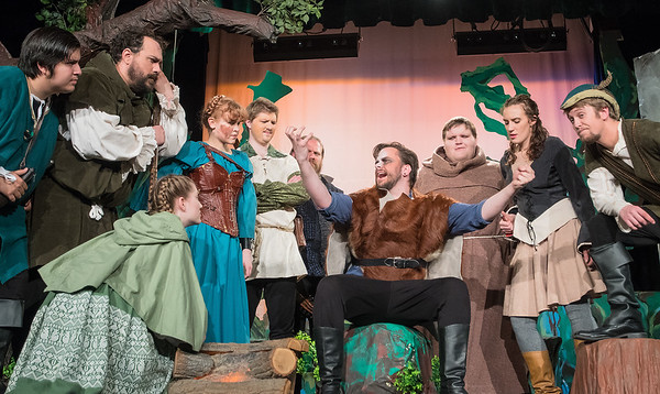 Robin Hood (far right), played by James Kelley, and his clan gather around Guy of Gisbourne, played by Zach Bolland, during a dress rehearsal at Lincoln Community Center on Tuesday. Photo by Jackson Forderer